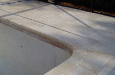 Faux Travertine Tiles Around Pool
